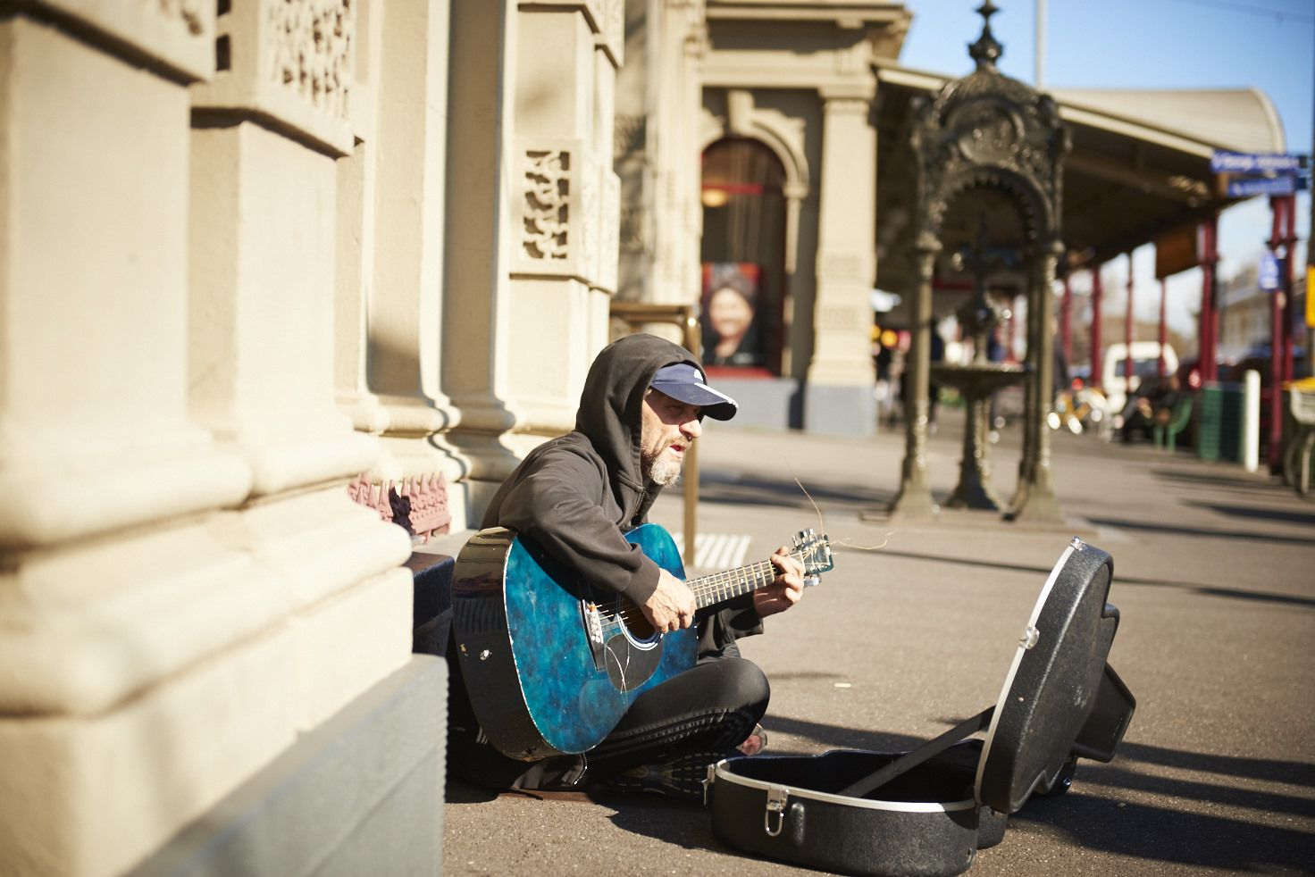 Homeless person busking